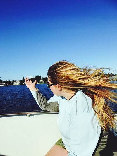 Going with the wind and where the sea takes me! Florida Keys Sea One Person Clear Sky Lifestyles Outdoors Young Women
