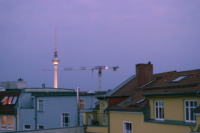 Architecture Berlin Blue Building Building Exterior Built Structure City City Life Communications Tower Construction Crane Dusk In The City Fernsehturm No People Prenzlauerberg Residential Building Residential District Rooftops Sky Tall Tinted Tower