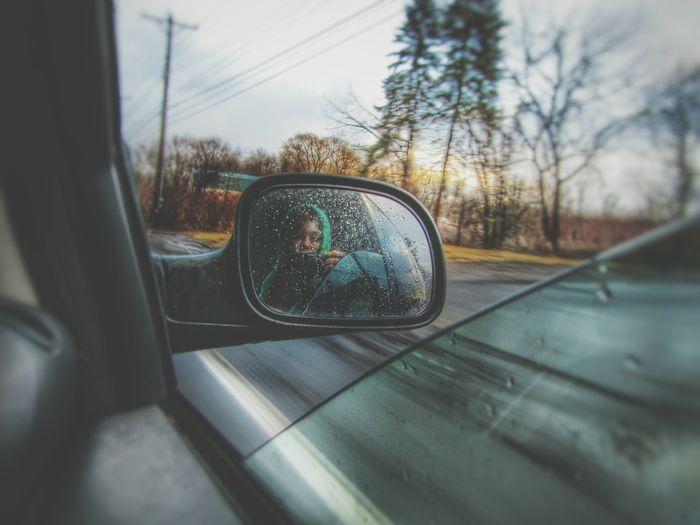 Woman Taking Selfie In Side-View Mirror Reflection