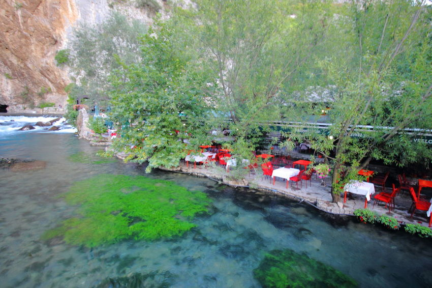 Cafes sitting along the spring of Buna River in Blagaj, Bosnia & Harzegovina. Blagaj Bosnia And Herzegovina Travel Beauty In Nature Buna River Floating On Water High Angle View Nature Reflection River Scenics Tourism Tranquility Travel Destinations Water