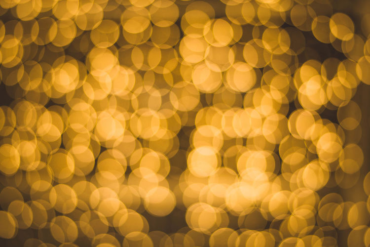 Bokeh light abstract and background. Bokeh Photography Bokeh Glowing Yellow Illuminated Backgrounds Gold Colored Lighting Equipment Celebration Christmas Pattern Night Gold