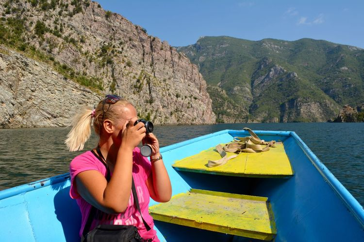 Woman in boat on mountain against mountains