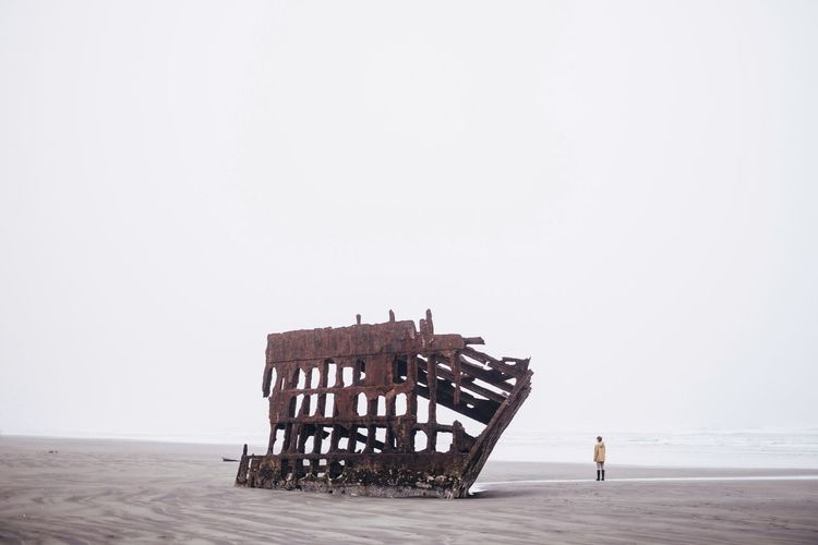 Wreck (find me on IG @noeldxng) Beach Sea Horizon Over Water Full Length People Outdoors Adult One Person Sky Rethink Things Tranquility The Week On EyeEm Perspectives On Nature Nature Oregon Standing Scenics Adventure Landscape Oregon Coast Wreck Of The Peter Iredale Sand Minimal Be. Ready. Go Higher A New Beginning Capture Tomorrow