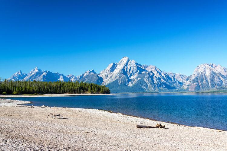 Rocky shore of jackson lake in grand teton national park