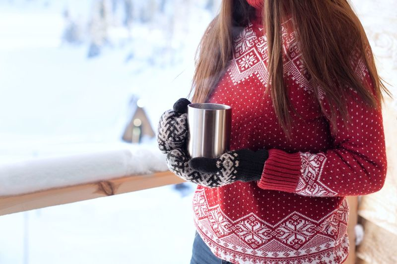 Young woman in red sweater with hot drink in winter Steam Village View Hot Tea Cozy Hot Drink Sweater Sweaterweather Winter Morning In The Mountains Warming Snowy Mug Holding Lifestyles Women Midsection Day Leisure Activity Cold Temperature Winter Mug Coffee Cup Warm Clothing