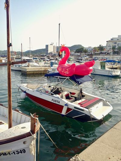 Modern figurehead. Beach Life Flamingo Mallorca Marina SPAIN Beach Toy Boat Life Floating Objects Harbor Inflatable  Moored Motorboat Nautical Vessel Pier Plastic Toy Port Rope Toy Transportation Water