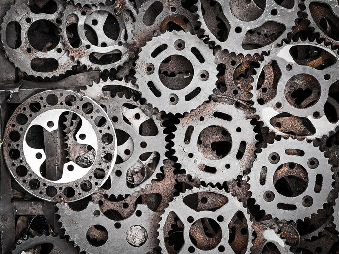 Abundance Backgrounds Circle Close-up Cogwheels Day Design Directly Above Full Frame Gear Gearshift Geometric Shape Hole Indoors  Large Group Of Objects Metal No People Pattern Shape Stack Still Life Textured  Textured Effect
