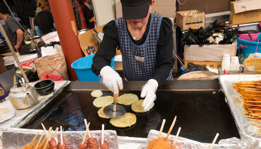 Cooking Eating Food And Drink Freshness JEJU ISLAND  Market Work Working Concentrating Day Finger Food Focusing Food Human Hand Indoors  Occupation One Person Pancake People Preparation  Real People Stall Street Food Tapioca Women