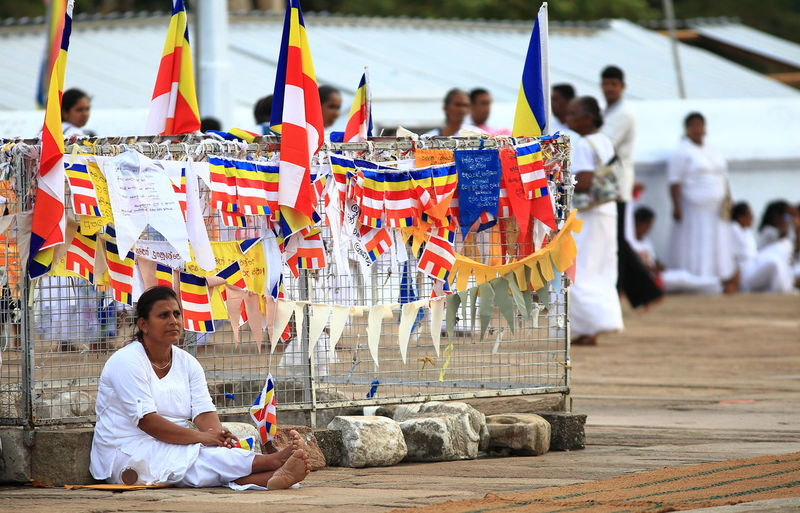 ASIA Buddhist Meditation Meditation Time Meditation Place Ruwanwelisaya Sri Lanka Adult Buddhism Buddhist Culture Buddhist Flags Buddhist Temple Dagoba Faithfullness Focus On Foreground Happiness One Person Peaceful Peaceful Moment Peaceful Place Real People Religion Smiling