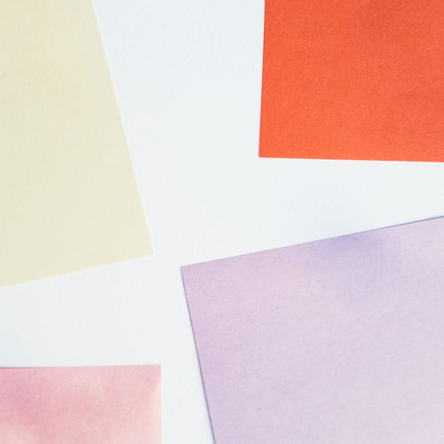 Close-up of colorful adhesive notes against white background