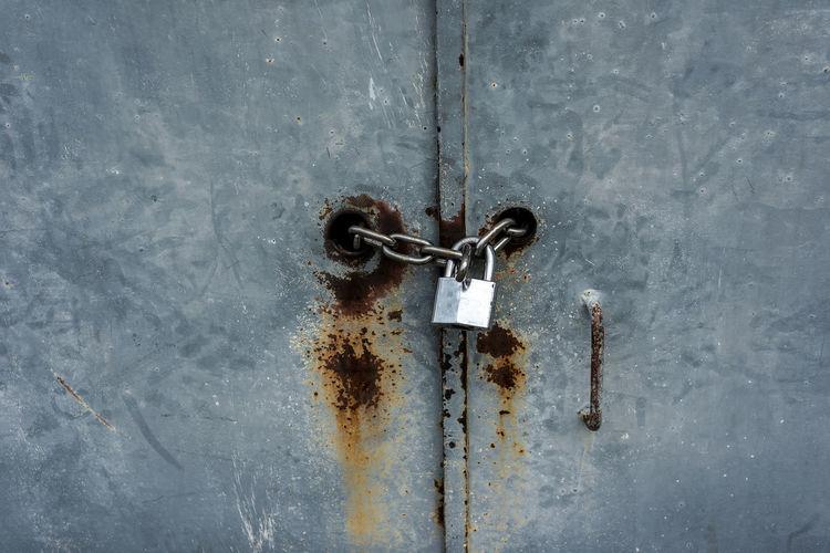 Close-up of padlock on metal door