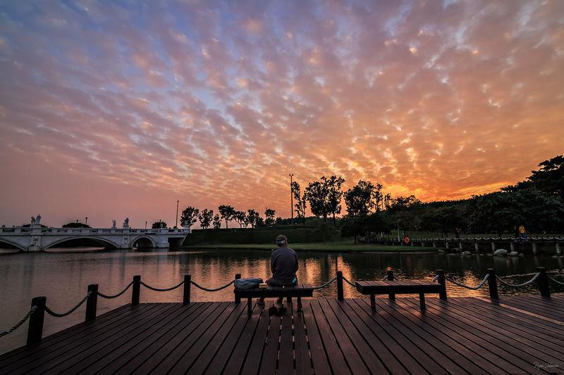 Always wondering... EyeEm Selects EyeEmNewHere Water Tree Sunset Beach Full Length Blue Reflection Lake Summer Sky Bench Lakeside Footbridge