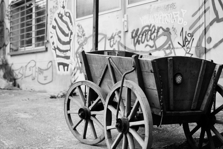 Architecture Berlin Blackandwhite Built Structure City Day Deterioration EyeEm Best Shots - Black + White Focused Graffiti Hello World Leaning Light Moment No People Outdoors Parked Parking Rolling Shadow Shadows & Lights Street Stroller Wheel Wheel