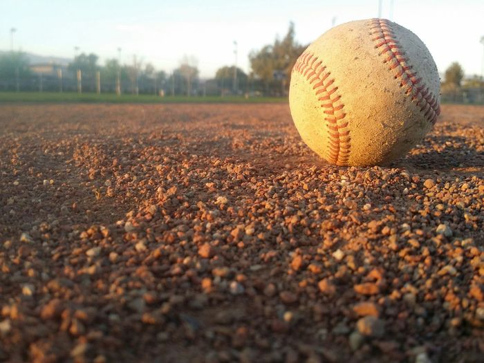 Close-up of baseball on field