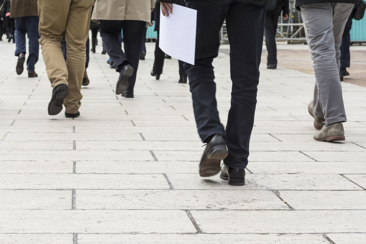 People in casual clothing walking. Blurred motion Men Motion Blurred Motion Sidewalk Legs Walking Outdoors Business Businessman Feet Rush Hour Hurry person Success Urban Pedestrian Pace Modern People Commuters Casual Clothing Busy City Life Steps