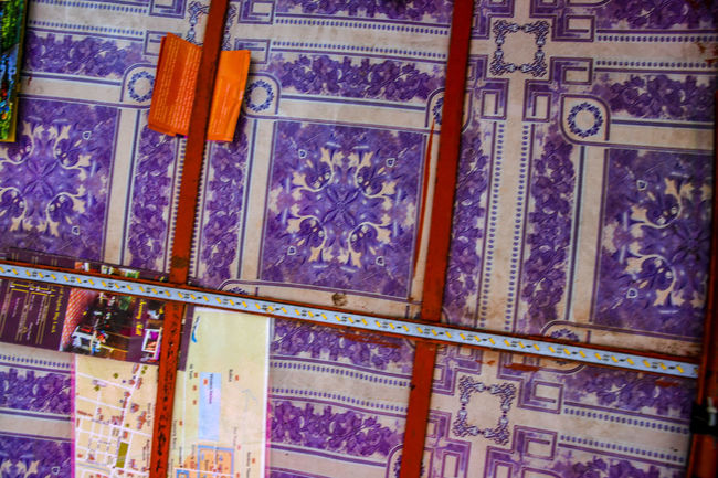 TukTuk Art And Craft Backgrounds Choice Craft Creativity Day Full Frame History Human Representation Low Angle View Multi Colored No People Ornate Pattern Purple Representation Wall - Building Feature