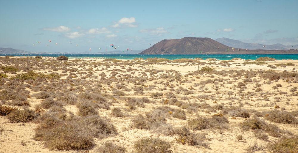 Beach Beauty In Nature Day Desert Fuerteventura Isla Del Lobos Mountain Nature No People Outdoors Postcard Sand Scenics Sea Sky Sunlight Tranquility Travel Destinations Water