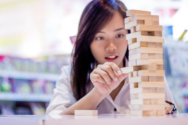 Wood Block Be. Ready. Jenga Meditation Meditation Place Plant Practice Concentration Entertaintment Game Headshot Joy Portrait Stack Strategic Young Adult Young Women