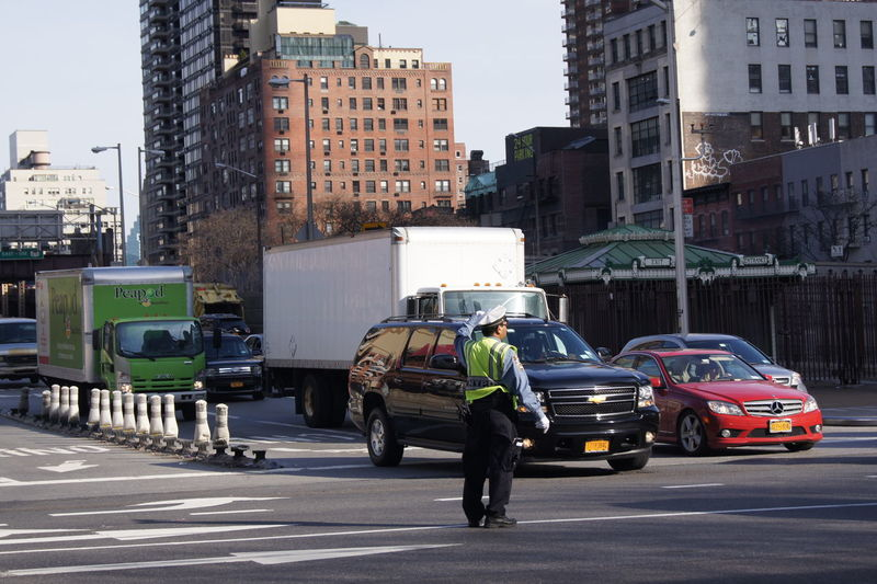 People doing their job, people trying to get through the traffic, just a regular day in the city... NYC NYC Photography NYC Street Photography NYC Street Police Force City People Regular Life City Life Structures And Architecture New York New York City New York ❤ Manhattan Traffic Trafficpolice Trafficincontrol Traffic Trafficinthecity