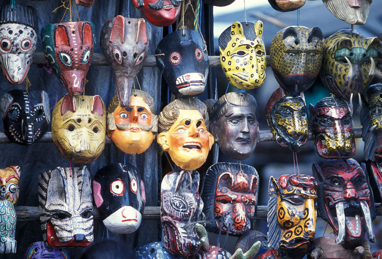 Full frame shot of various masks for sale at street market