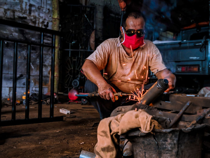 Man working on metal structure