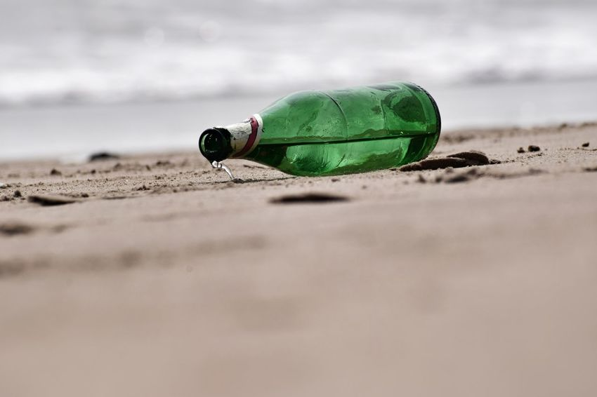 Beer bottle Beer Bottle Green Sand Sea Seabeach Greenbottle Outdoor No People Beach Green Color Sand Day No People Nature Outdoors Close-up