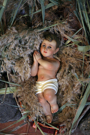 A baby Jesus figure on Christmas, Church of St. Peter's Primacy, Tabgha, Israel Bethlehem Birthplace Christianity Christmas Church Holy Holy Land Israel Jesus Middle East Monastery Nativity Palestine Peter Primacy Religion Religious  Saint Shrine Tabgha