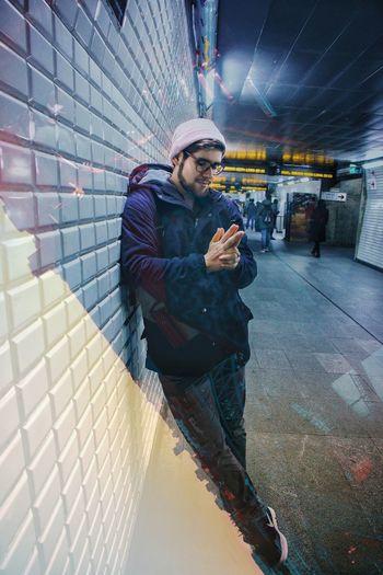 Full length portrait of man using mobile phone at night