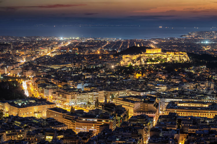 Aerial view to the illuminated skyline of Athens featuring the Acropolis, Parliament and streets leading to the sea Building Exterior Cityscape Architecture City Built Structure Illuminated Aerial View Building High Angle View Travel Destinations Night City Life Urban Sprawl Sky Athens Greece Acropolis Parthenon Syntagma Square Parliament Street Motion Lights Sea Panorama