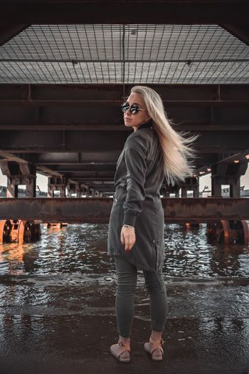 Sunglasses Young Women One Person Water Lifestyles Standing Portrait Day Outdoors People Full Length Young Adult Built Structure Real People Architecture Leisure Activity Building Exterior Beautiful Woman
