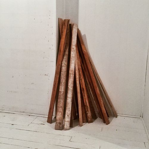 Wooden Planks Leaning Against Floor At Home