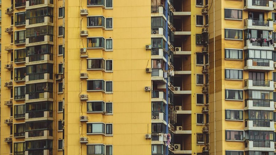 Architecture Building Exterior Window Built Structure Yellow Full Frame Building Balcony Residential Building Fire Escape Outdoors Apartment City Residential  No People Day Low Angle View