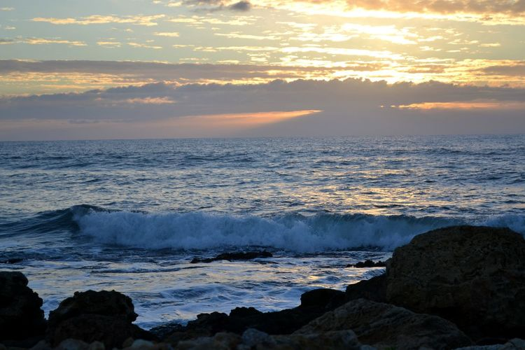 Waves Romantic Sky Sea Sun Sunlight Sunset Light And Shadow Light Red Red Light Wind Blue Blue Sky Blue Wave Wave Coast Coastline Sky Skyscraper Eyeemphotography EyeEm Best Shots Landscape Sandy Beach Surf Coastal Feature Dramatic Sky