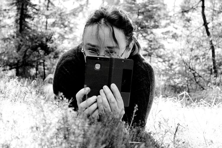 EyeEm Selects One Person Day Forest Outdoors Holding Nature Mature Adult Adult Leisure Activity People Technology Wireless Technology Women One Woman Only Real People Tree Childhood Adults Only Only Women Warm Clothing Selfportrait Second Acts Black And White Friday