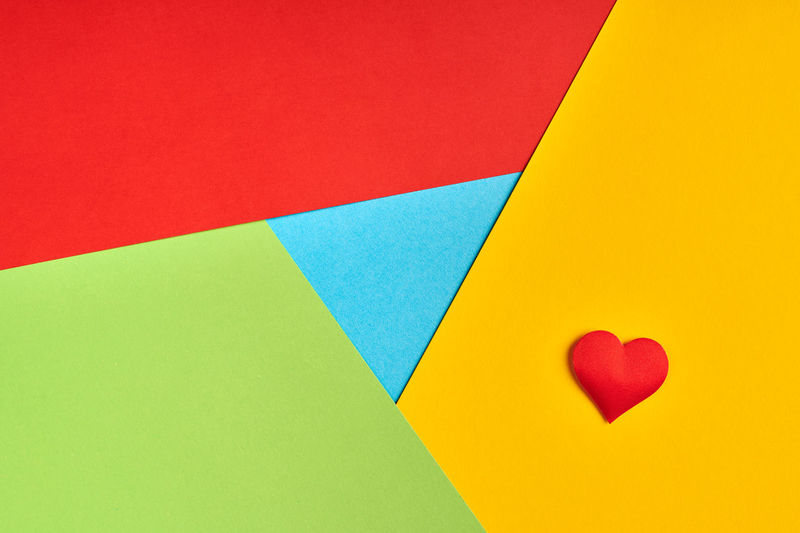 High angle view of multi colored heart shape on paper