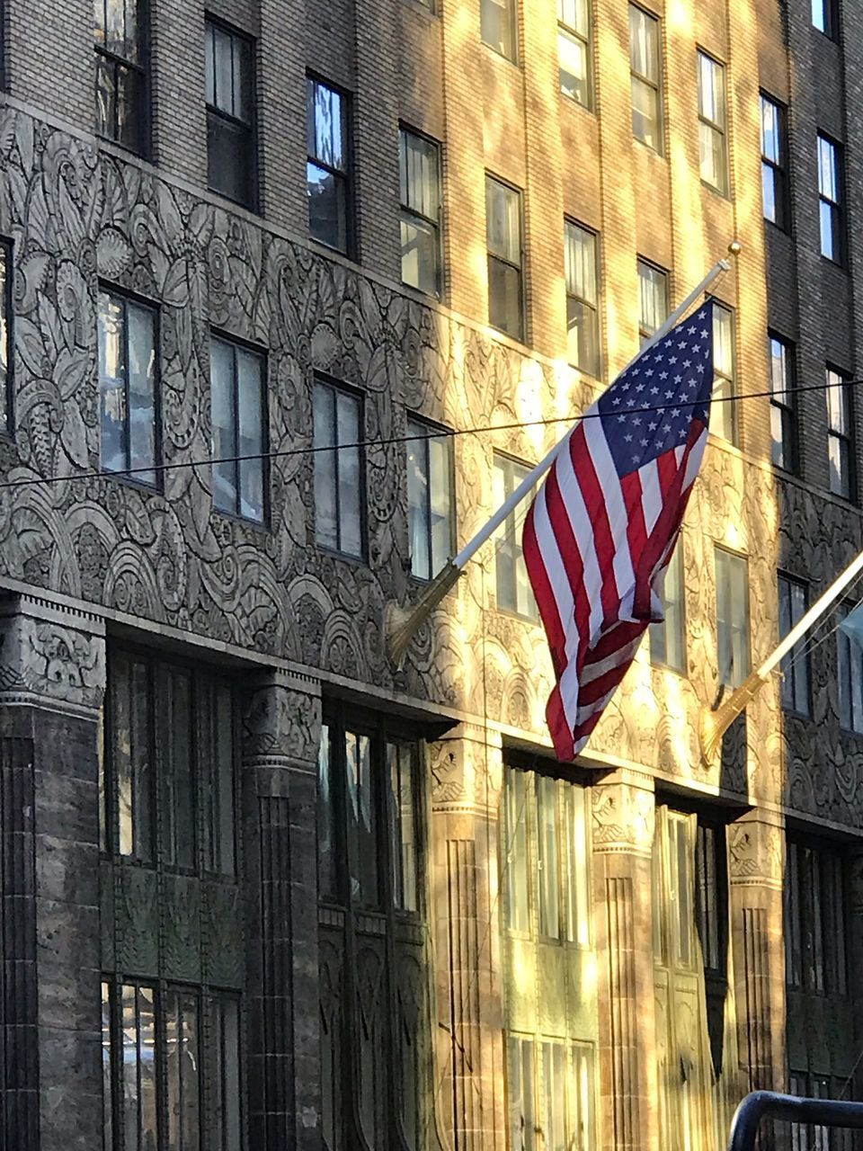 building exterior, built structure, architecture, flag, patriotism, building, window, striped, no people, day, city, sunlight, outdoors, nature, low angle view, shape, star shape, national icon