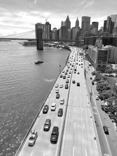 View to Brooklyn Bridge River View Bridge New York Built Structure City Architecture Building Exterior Water Sky Transportation Building Cloud - Sky Cityscape Outdoors High Angle View Office Building Exterior Car Street Day