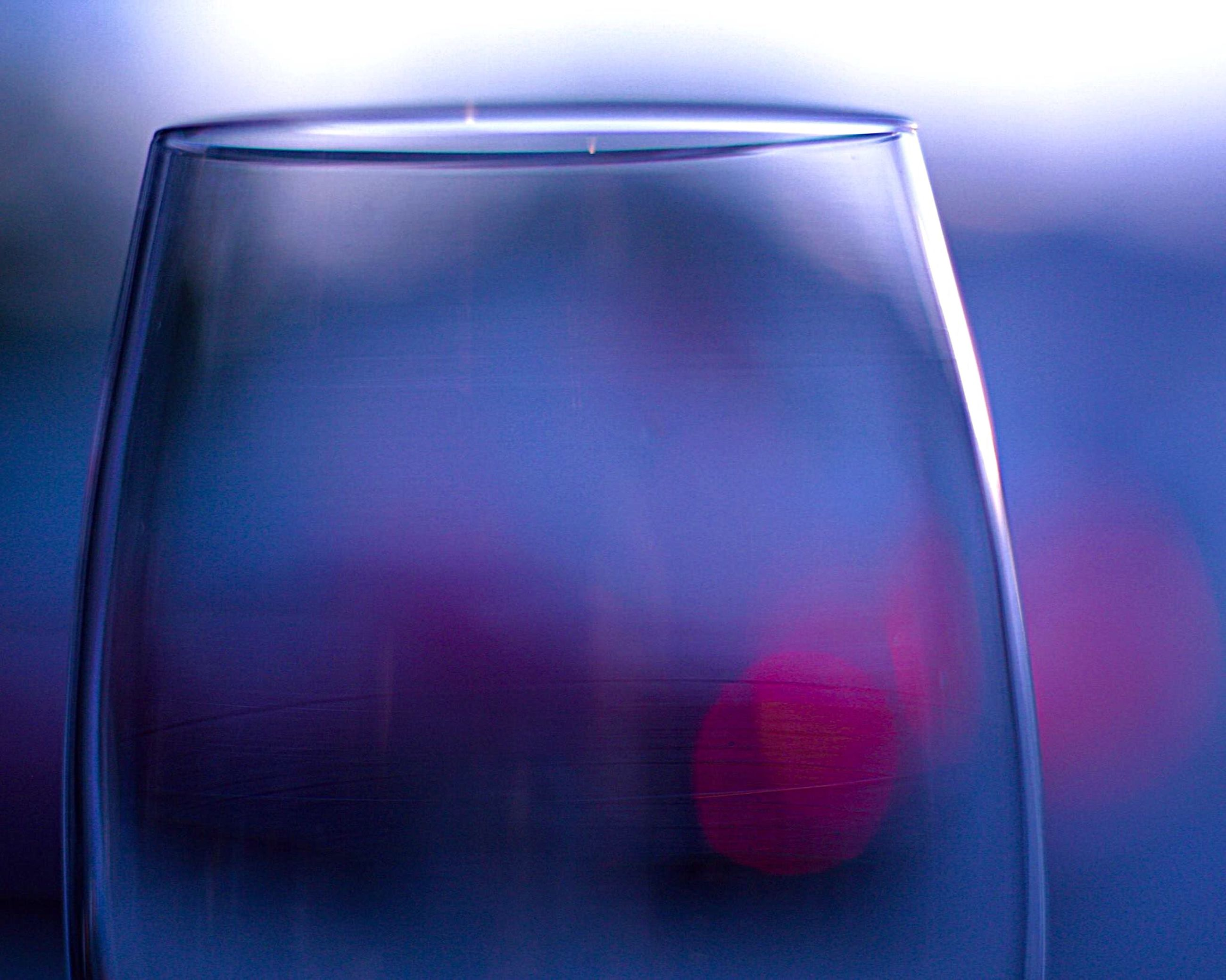 indoors, still life, close-up, glass - material, drink, transparent, food and drink, refreshment, table, drinking glass, glass, freshness, no people, single object, studio shot, reflection, focus on foreground, simplicity, red, white background