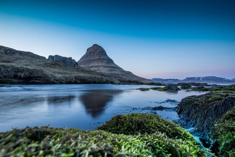 Island Sunset kirkjufell Nature Landscape Iceland Kirkjufell EyeEm Selects Water Sky Beauty In Nature Scenics - Nature Mountain Tranquility Sea Blue Nature Clear Sky Mountain Peak No People Plant Tree Mountain Range Idyllic