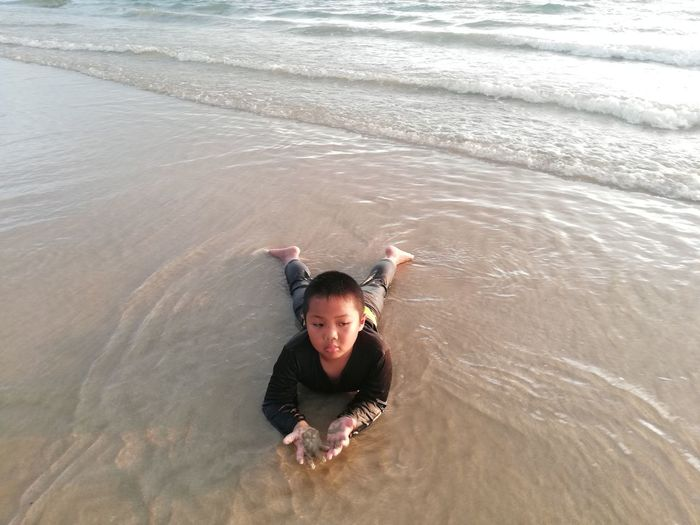 Children enjoy on summer trip 2019,หาดเจ้าหลาว Achi2019 Water One Person Leisure Activity Sea High Angle View Looking At Camera Portrait Lifestyles Real People Motion Waterfront Swimming Childhood Nature Child Day Males  Outdoors Innocence Human Arm Boy