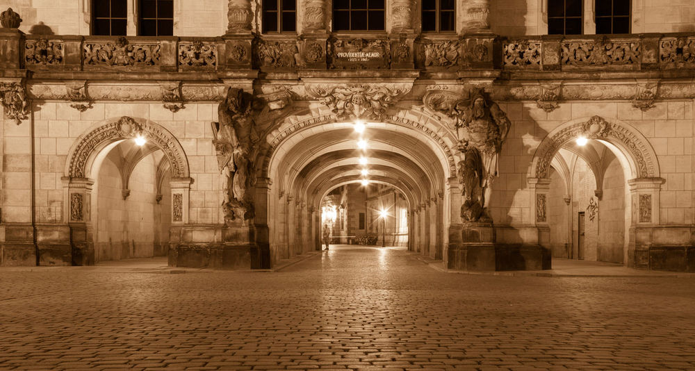 Architecture Empty Places Gate Night Lights Night Photography Nightphotography Reflection Arch Architectural Column Architecture Architecturelovers Baroque Building Exterior Built Structure City Cobblestone Empty History Illuminated Night No People Old Buildings Outdoors Street Travel Destinations