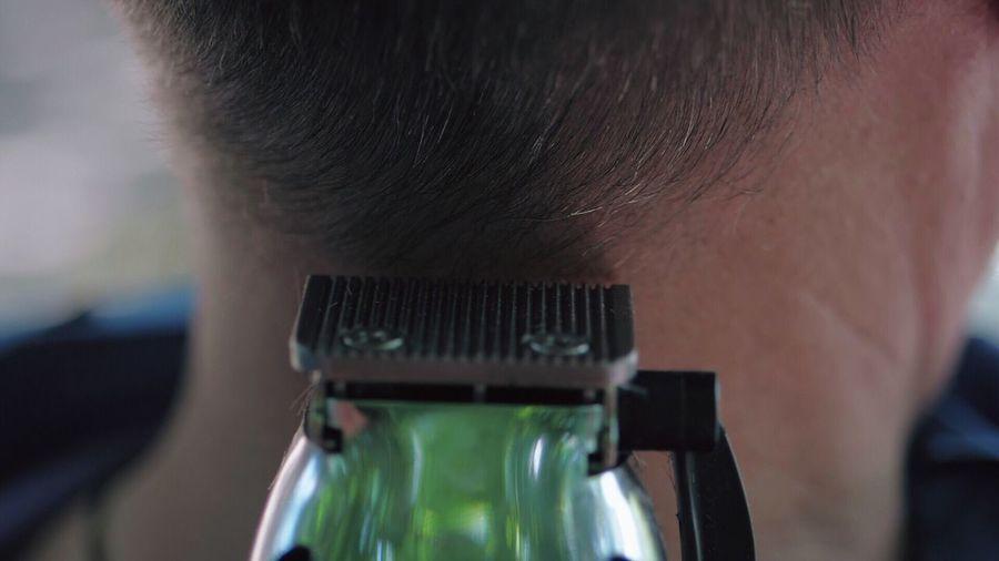 Electric razor cutting hair of man