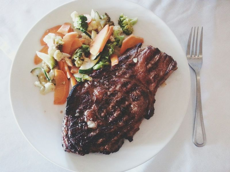In my world, no food beats a good ribeye steak with steamed vegetables. Gotta love ribeye! Although, we all know that fork won't do... Food Porn Awards Food Porn Food Photography Delicious Meatlovers Ribeye Steakhouse Ribeye Steak Vegetables Lunchtime