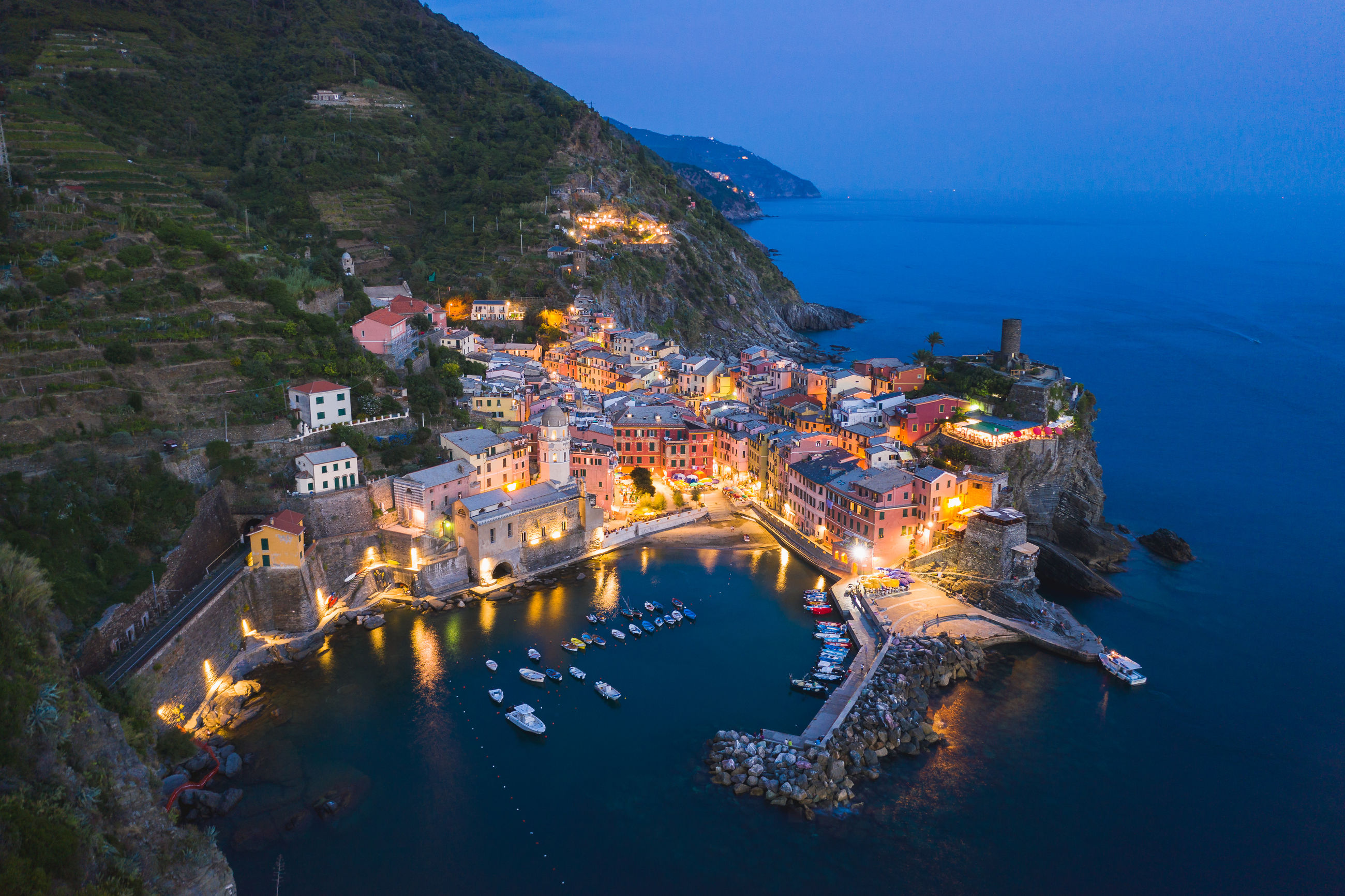 water, architecture, sea, building exterior, built structure, illuminated, high angle view, nature, mountain, building, no people, land, outdoors, sky, travel destinations, scenics - nature, dusk, night, the past