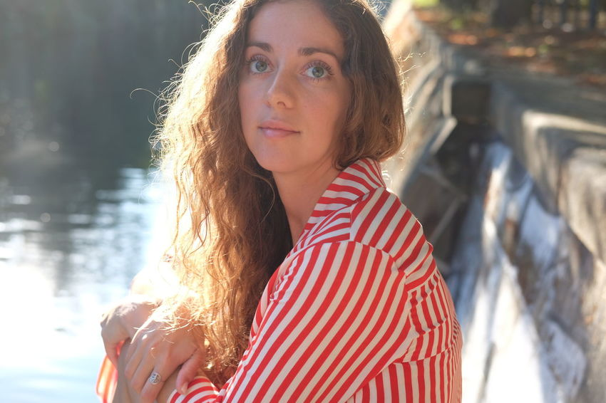 Summer by the river Adult Beautiful Woman Brown Hair Casual Clothing Focus On Foreground Hair Hairstyle Headshot Leisure Activity Lifestyles Long Hair Looking At Camera One Person Portrait Real People Striped Women Young Adult Young Women