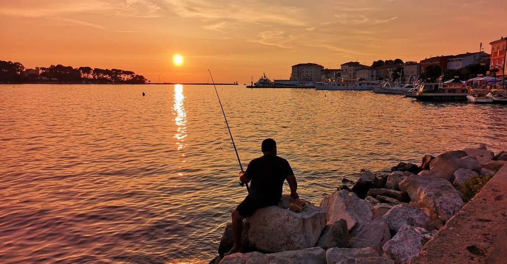 EyeEm Selects City Cityscape Sunset Beach Sea Water Sunlight Silhouette Multi Colored Horizon Coast Romantic Sky Atmospheric Mood