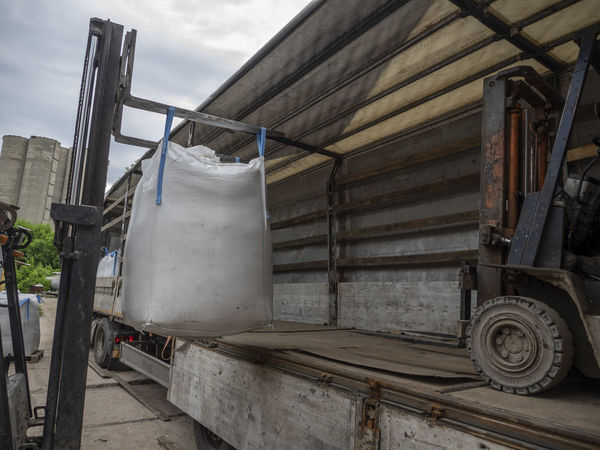 Loading big bags into the truck Big Bag Architecture Building Exterior Built Structure City Cloud - Sky Day Industry Land Vehicle Loading Low Angle View Metal Mode Of Transportation Nature No People Outdoors Semitrailer Sky Transportation Truck Wood - Material