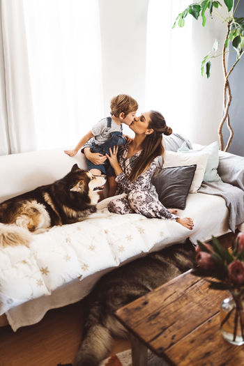 Cuddle Family Fun Happy Home Love Morning Mother Quality Time Young Mom Boy Child Child Hood Cute Dog Domestic Domestic Animals Husky Indoors  Mom Offspring Pets Pyjamas Toddler  Togetherness