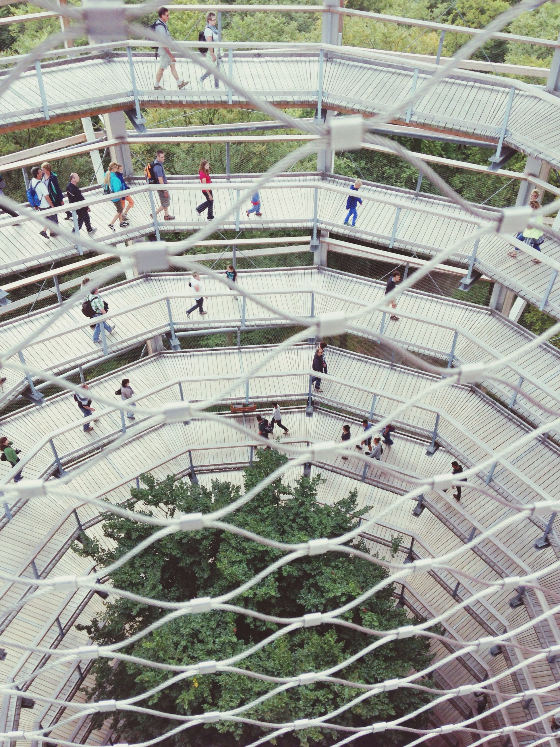 high angle view, large group of people, architecture, built structure, city, building exterior, city life, incidental people, person, men, day, lifestyles, leisure activity, transportation, travel, outdoors, sunlight, pattern, travel destinations