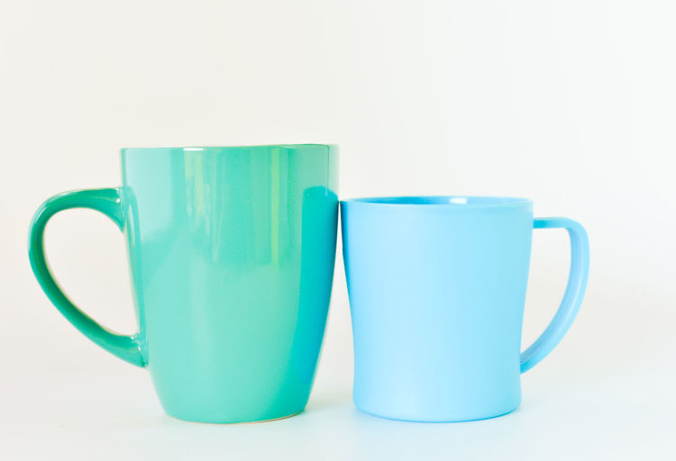 Close-up of blue cup against white background
